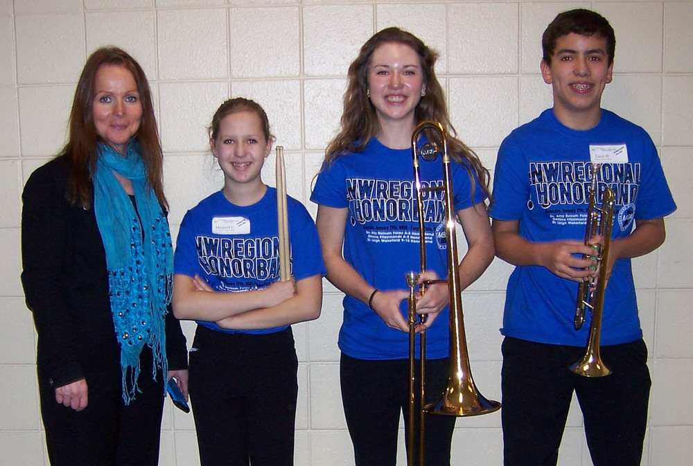 Grades 6-8 Blue Band featured WDC students, second from left: Maggie Carlson, Sophia Kreklau and Lucas Hinojos, and far left, Geneva Fitzsimonds, Band Director from Southview Middle School, Edina. (Photo courtesy of MBDA)