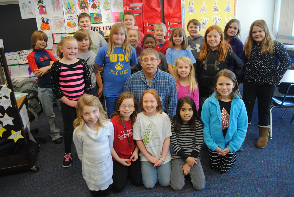 "Mrs. Finn's third-grade class enjoyed listening to Wadena Mayor George Deiss read two books on Feb. 24 as part of "" I Love to Read Month"" activities. Here, Mayor Deiss is surrounded by the class. The book ""Don't Spill the Milk"" takes place in Africa, which fits into the ""I Love to Read Month"" theme of ""Read Around the World!"" The class has also visited Finland in Europe (how fitting of Mrs. Finn!), Australia and Asia through books they've read in class. They have three more continents to visit to reach their goal of seven."