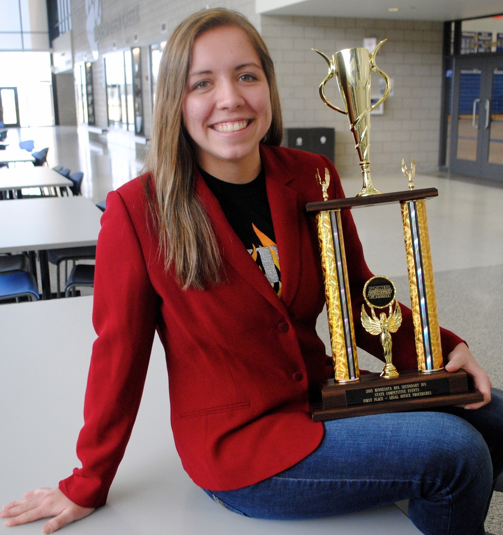 "Maddy Hinojos, a senior, qualified for the National Leadership Conference May 6-9 in Anaheim, Calif.  She is shown here with her State BPA trophy, where she earned first place in the ""Legal Office Procedures"" category."