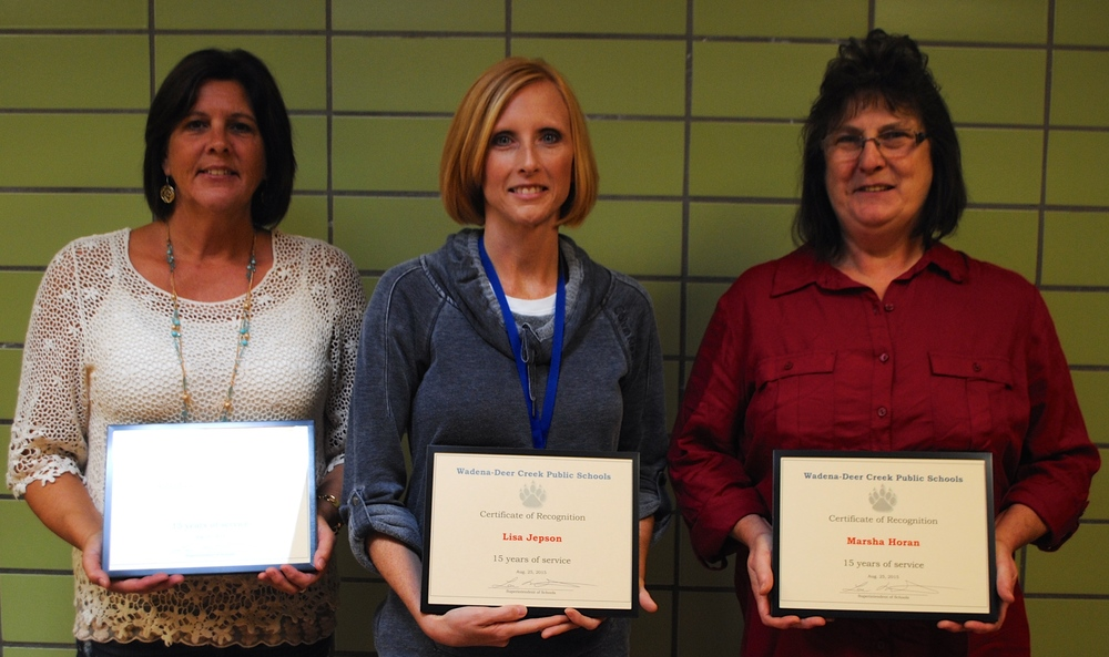15 years of service: from left, Laura Zeise, preschool paraprofessional; Lisa Jepson, math teacher; and Marsha Horan, bus driver. Not pictured: Ellen Carlstrom, elementary paraprofessional; and Mike Brunsberg, English teacher.