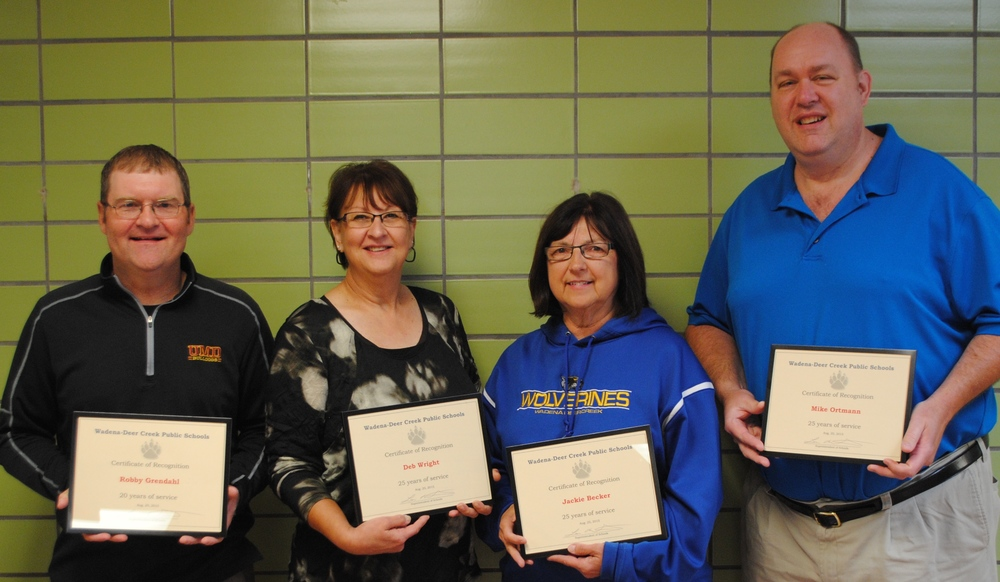 20 and 25 years of service: from left: Robby Grendahl, social studies teacher, 20 years; and Deb Wright, high school paraprofessional; Jackie Becker, middle/high school administrative assistant/school store coordinator; and Mike Ortmann, music teacher; all 25 years.