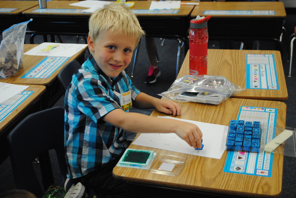 WDC first-grader Bryce Hopp works on his alphabet letters during his first day in Mrs. Kellen's class. The first-grader said he was having a great first day. (Photos by Dana Pavek, WDC Schools)