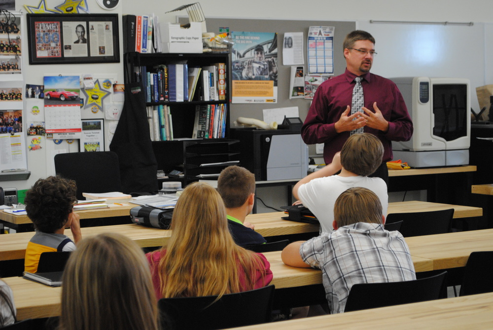 Engineering and Technology Teacher Mike Shrode talks to eighth-grade students on Sept. 1 about the Gateway to Technology curriculum. Students will design and engineer windmill fins and a robotic dragster.