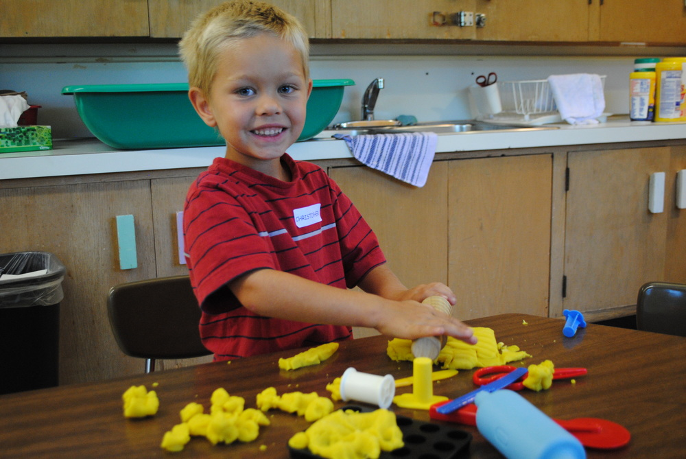 Christopher Ruth, 4, enjoys making shapes out of play dough on his first day of preschool at Wadena-Deer Creek.