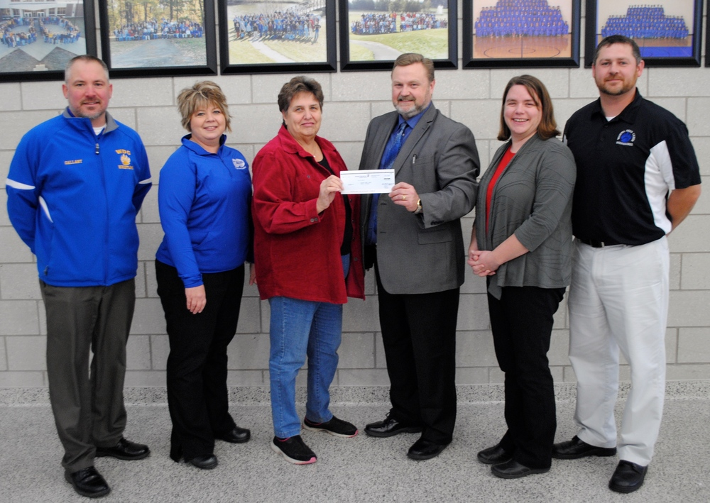 Modern Woodsmen Insurance presented a matching grant of $2,500 recently to Never.Give.Up. and Wadena-Deer Creek Schools. Pictured, from left: Norm Gallant, WDC activities director; Nancy Pierce, Never.Give.Up. representative; Cecelia Harrison, Activities Coordinator, Modern Woodmen Insurance; Lee Westrum, WDC superintendent; Toni Kraska, WDC school counselor; and Tyler Church, WDC grades 5-12 principal. (Photo by Dana Pavek, WDC Schools)
