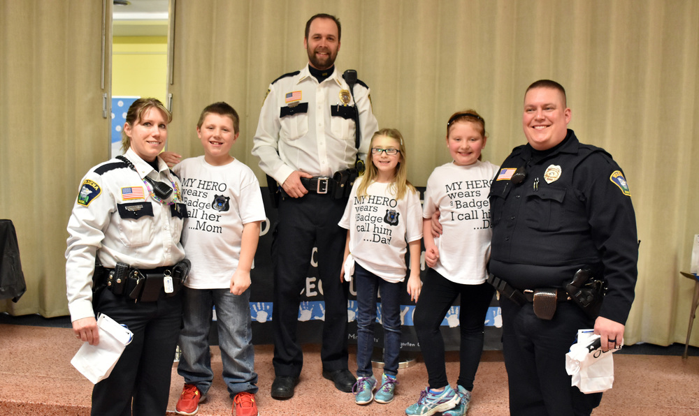 "A few of the Wadena-Deer Creek Elementary students who have parents in law enforcement pause for a photo at the school's first-ever ""Lunch with Law Enforcement"" event. From left are Wadena Police Department Chief Naomi Plautz, with son Jacob; Verndale Police Chief Cory Carr, with daughter Addi; and Ava with her dad, Wadena Police Officer Aaron White. (Photo by Anna Erickson, Wadena Pioneer Journal)"