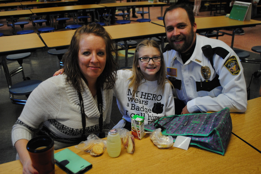 Stacy Carr, left, came across the idea to host a law enforcement luncheon on a blog for families who work in law enforcement. She's pictured here with her husband, Cory, right, who serves as the Verndale Chief of Police, and daughter Addi, a third-grader at Wadena-Deer Creek Elementary. They also have a daughter Alyssa, a first-grader. (Photo by Dana Pavek, WDC Schools)