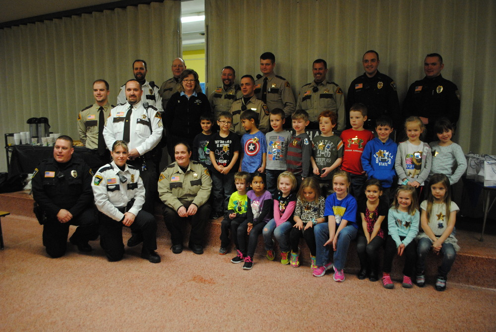 Wadena-Deer Creek Kindergarten students in Mandy Gallant's class have their photo taken with local law enforcement on January 15 at the elementary cafeteria. (Photo by Dana Pavek, WDC Schools)