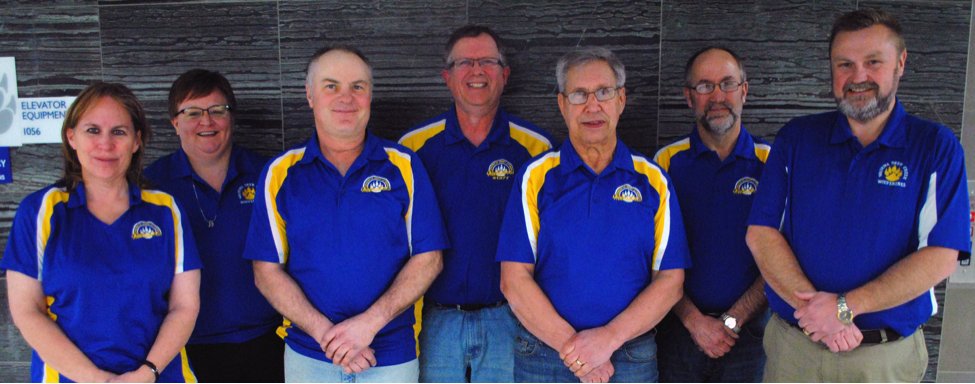Wadena-Deer Creek school board members being honored this week include, from left: Ann Pate, Jil Fiemeyer, Wayne Perkins, Kent Schmidt, Stephen Techam, Peter Hayes and Supt. Lee Westrum. Photo by Dana Pavek.