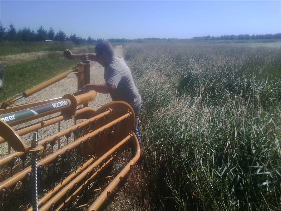Ethan Benson adjusts a twin-basket rake for his Diversified Agricultural Production Placement Proficiency on his home farm, Benson Dairy. Courtesy photo.