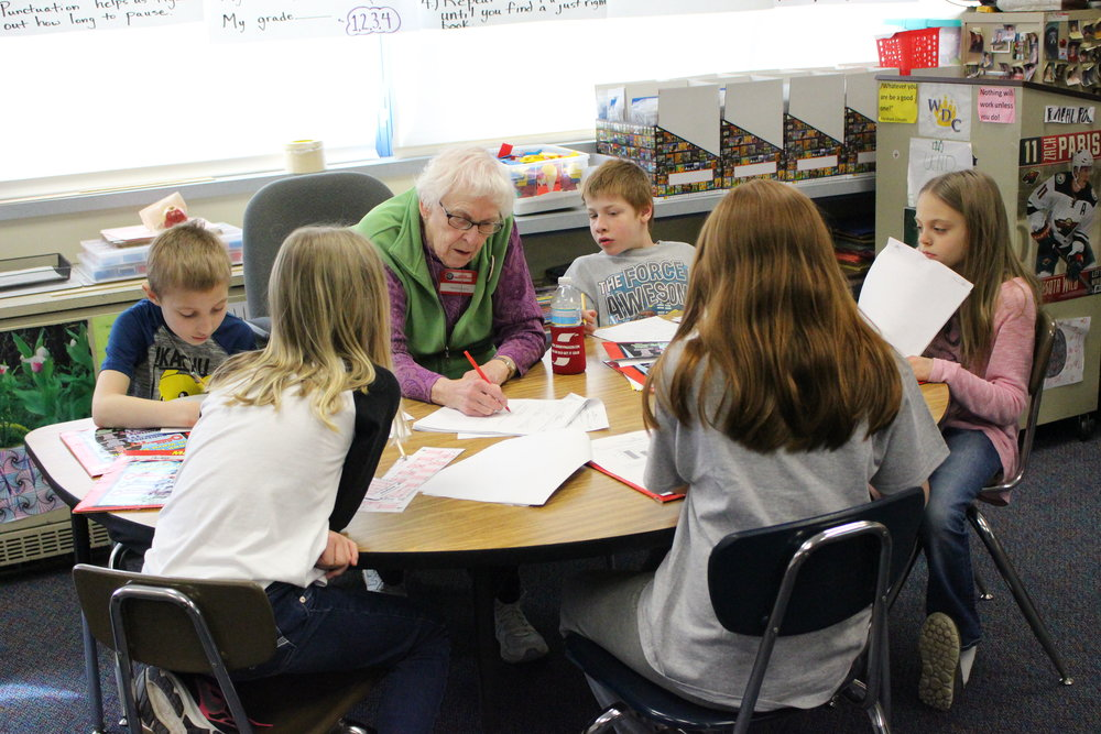 Foster Grandma Leona Porter said spending time with children is what she loves. She's pictured her helping third-grade students with Accelerated Math in Mr. Mehl's classroom.