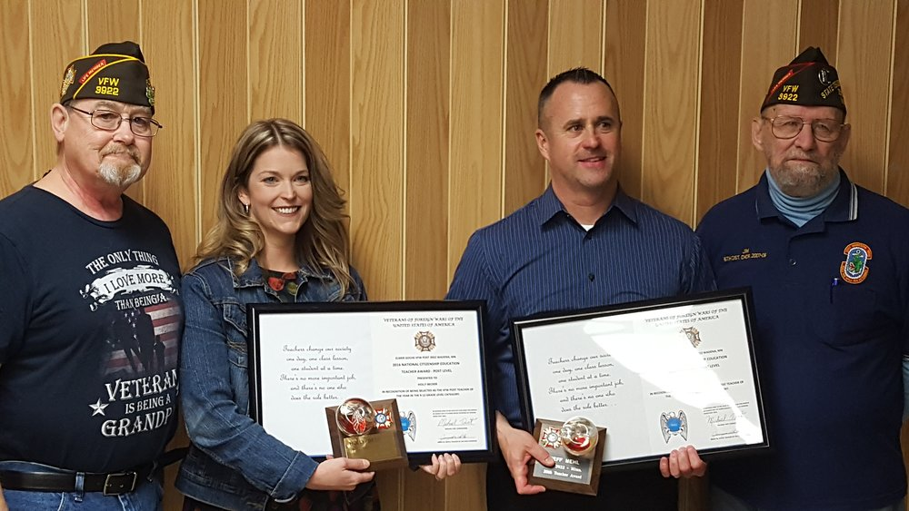 Pictured at the award presentation, from left to right: Michael Tast, Wadena VFW Commander; Holly Becker, Jeff Mehl, and Jim White, VFW Teacher of the Year Committee Chair. Photo by Louis Rutten, WDC Schools.