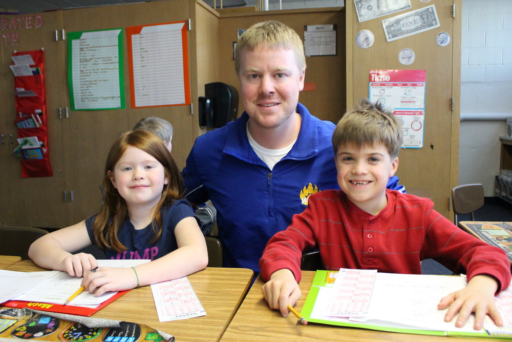 Kevin Tumberg with two of his second-grade students Zoie Ellingson and William Osberg at WDC Elementary. His biggest influence on becoming a teacher? His mom, Barb, who has been teaching kindergarten in the same classroom for 34 years at New York Mills.