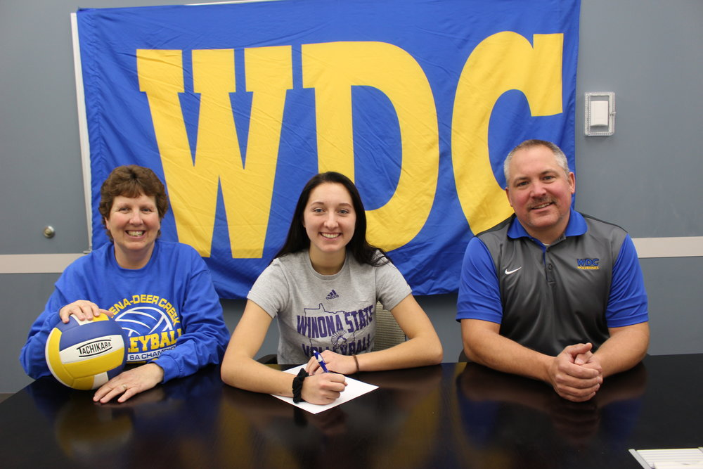 WDC student-athlete Casey Volkmann signed a letter of intent on Nov. 14 to play volleyball for the Winona State University Warriors. Pictured above, from left: Sue Volkmann, WDC head volleyball coach and Casey's mom; Casey Volkmann; and Norm Gallant, WDC activities director. (Photo by Dana Cantleberry, WDC Schools)