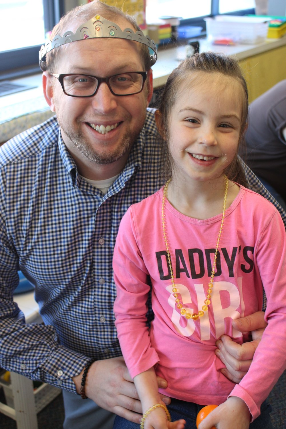 "Dads like Ryan Damlo, left, and his daughter, Kylie, played board games, colored pictures, made art projects and more during ""Donuts for Dads."""