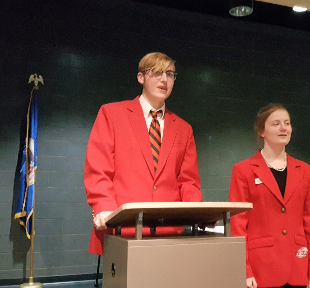 Elliot Doyle and Angela LeComte leading the closing ceremony.