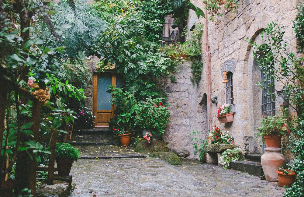 Plant lined streets in Civita di Bagnoregio, Italy