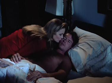 Dana kisses Adam goodbye