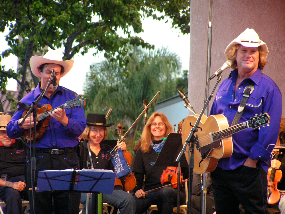 Sharon Cooper, Concert Master;  Cyndi Hall, Assistant Concert Master with Riders of the Purple Sage