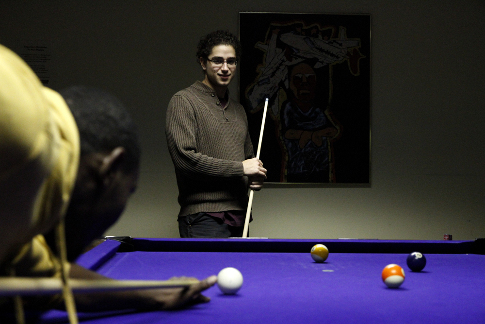 Two Western students play pool at the Underground Cafe, Monday, Nov. 26, 2012.