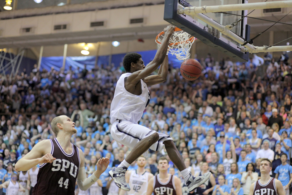 Western's Anye Turner (10) makes a slam dunk with just under three minutes left in the game. Western Washington University men's basketball team defeated Seattle Pacific University 62-58, Tuesday, Feb. 19, 2013, during the NCAA II West Regional final at WWU in Bellingham.