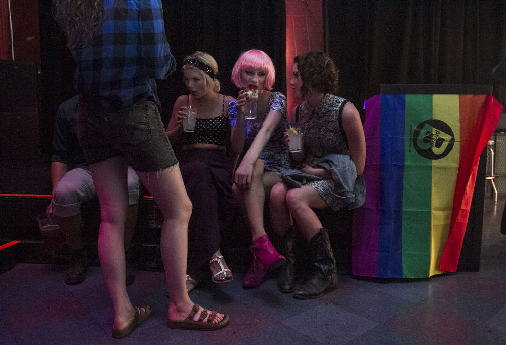 During a break in the Imperial Sovereign Court of the Evergreen Empire Bellingham Pride Drag Show, drag queen and master of ceremonies Wilma Cherrypop, second from right, hangs outs with her roommates Carly Busch, right, Sam Christensen, left, and Kayla Howich, back turned, Saturday, July 13, 2013, at Rumors Cabaret. Drag queens and performers donated their tips to Bellingham Pride and Safe for Free, a condom distribution program, which totaled just more than $1,000. The drag show was one of many Bellingham Pride weekend's festivities.