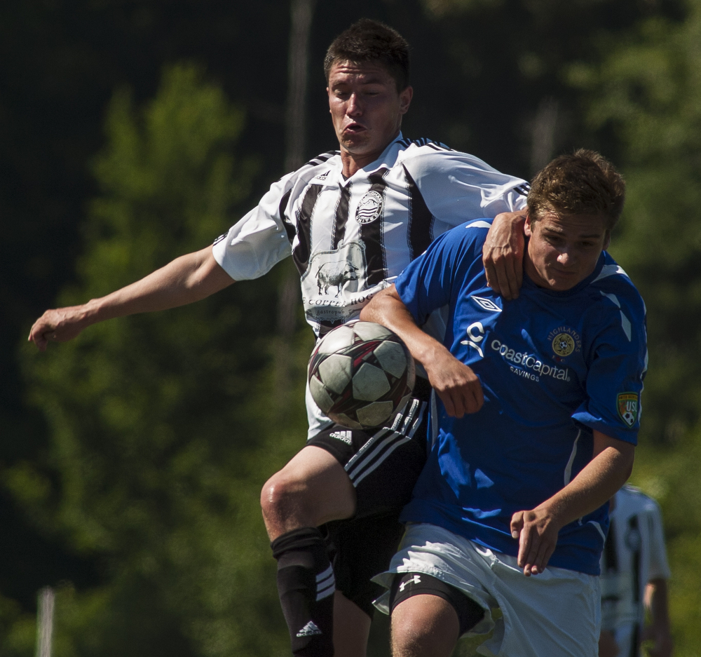 Bellingham United's Keith Ferris, left, and Victoria Highlanders' Brennen McCleary fight for the ball during the Hammers final season game at home. Bellingham United F.C. defeated Victoria Highlanders F.C. 2-1 in the Pacific Coast Soccer League, Sunday, July 21, 2013, at Civic Field in Bellingham. With the win against the Highlanders, the Hammers qualified to compete in the Challenge Cup, which will be played in July 27-28 in Coquitlam, British Columbia.