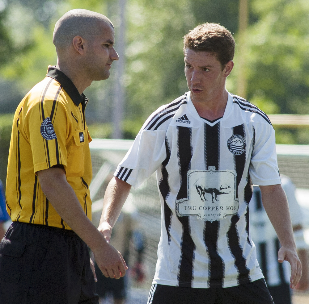 Bellingham United's Kellan Brown (2) debates what he thought was a missed call during the Hammers final regular season game. Bellingham United F.C. defeated Victoria Highlanders F.C. 2-1 in the Pacific Coast Soccer League, Sunday, July 21, 2013, at Civic Field in Bellingham. With the win against the Highlanders, the Hammers qualified to compete in the Challenge Cup, which will be played in July 27-28 in Coquitlam, British Columbia.