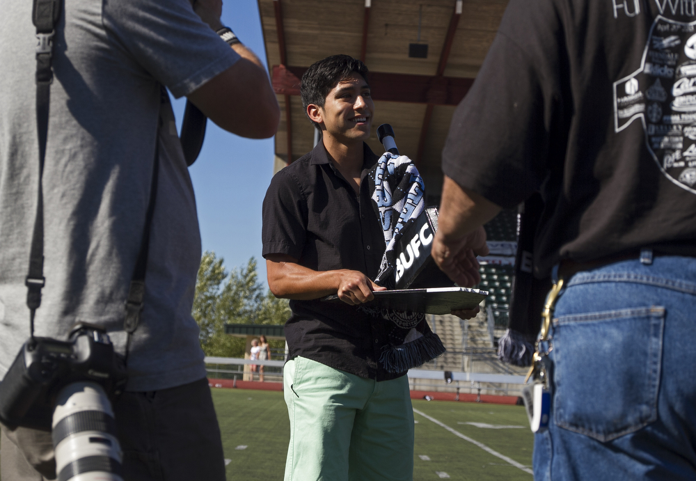 Bellingham United's Oscar Jimenez, center, is award a trophy for being the fan's favorite player. Bellingham United F.C. defeated Victoria Highlanders F.C. 2-1 in the Pacific Coast Soccer League, Sunday, July 21, 2013, at Civic Field in Bellingham. With the win against the Highlanders, the Hammers qualified to compete in the Challenge Cup, which will be played in July 27-28 in Coquitlam, British Columbia.