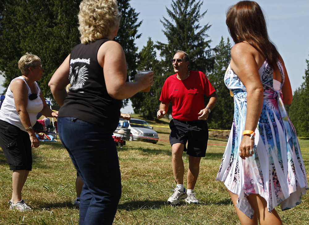 Skagit Woodstock organizer Reed Harlow, center, dances at the fourth annual Skagit Woodstock on Saturday, Aug. 10, 2013, in Conway, Wash. All proceeds of Skagit Woodstock are given to Skagit Valley Hospital Foundation. Nick Gonzales / Skagit Valley Herald
