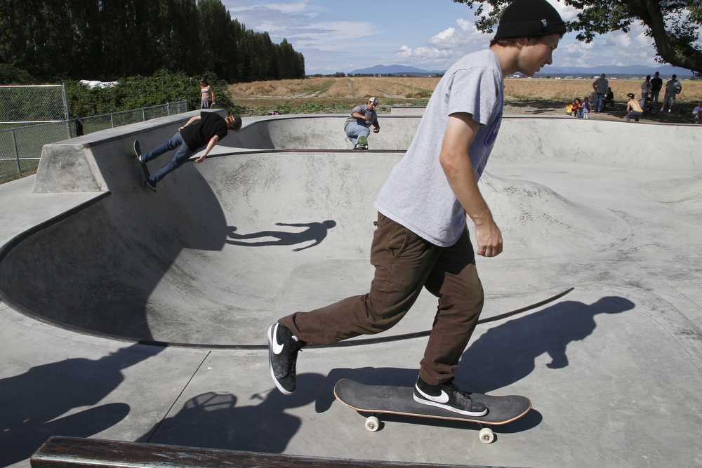 Dylan Dowd, 18, front, skates by during warms up for the top dog class at the First Annual La Conner Community Skate Competition on Saturday, Aug. 24, 2013, at La Conner Skatepark. Nick Gonzales / Skagit Valley Herald