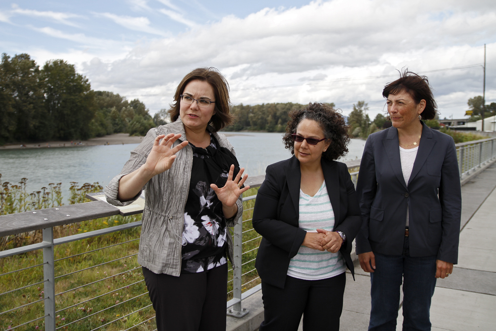 Mount Vernon Mayor Jill Boudreau (left) gives a tour of the Skagit River's flood banks to Nancy Sutley (center), Chair of the White House Council on Environmental Quality, and congresswoman Suzan DelBene on Thursday, Aug. 29, 2013, in Mount Vernon. A diverse group of policy makers from throughout the county met to talk with Sutley about what they are doing to plan for the impacts of climate change. Nick Gonzales / Skagit Valley Herald