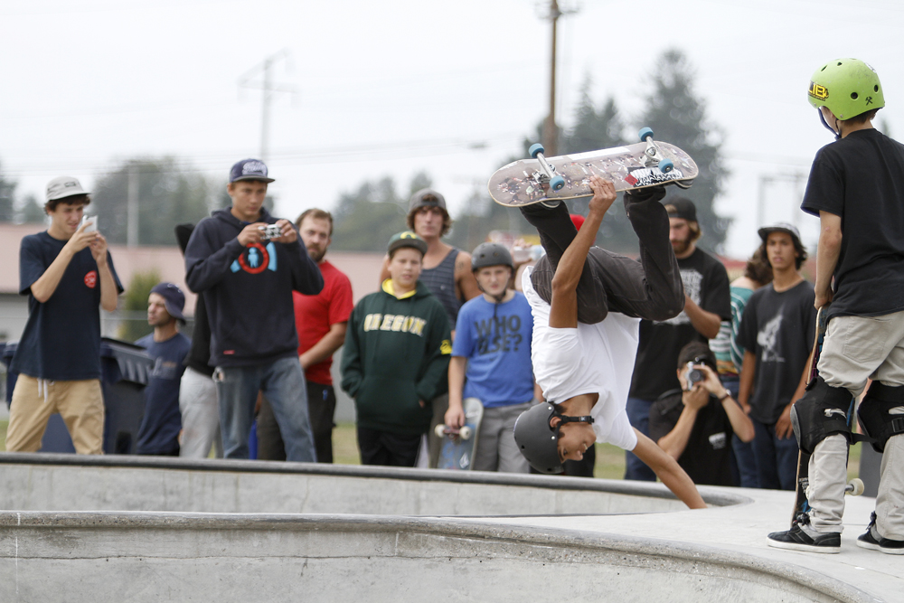Bellingham skater Victor Garcia does a Miller flip during the advanced class of the first Sedro-Woolley Skateboard Contest on Saturday. The event sponsored by the Parks and Recreation department and Hidden Wave Board Shop, drew out 34 skaters and many more to watch Lib Tech professional skaters, who judged the contest. Nick Gonzales / Skagit Valley Herald