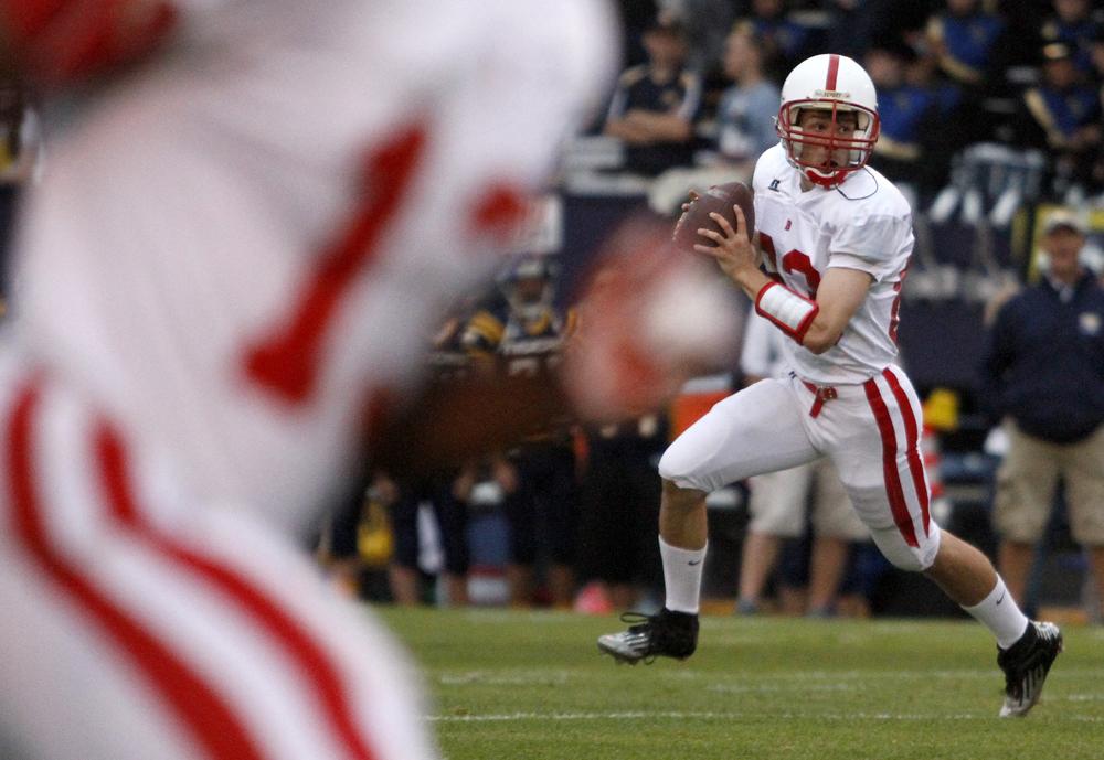 Bellingham's quarterback Eric Thompson scrambles in the first quarter on Friday, Sept. 13, 2013, in Burlington. Burlington-Edison beat Bellingham 42-21. Nick Gonzales / Skagit Valley Herald