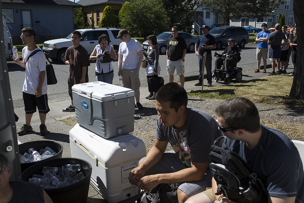 About 30 people wait in line for Bellingham's second retail marijuana store, 2020 Solutions on 2018 Iron St., to open on Thursday, July 10, 2014, in Bellingham. July 8 marked the first day Washington store could sell marijuana for recreational use. 2020 Solutions had to delay their opening due a problem with the state-licensed processors.