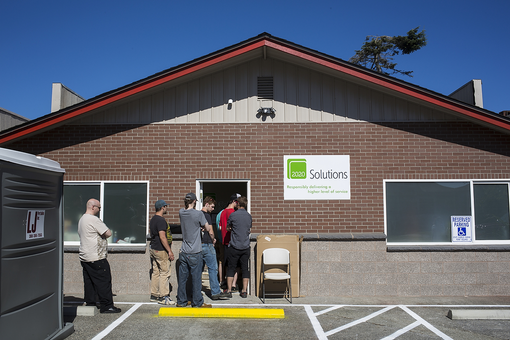 People file into 2020 Solutions on 2018 Iron St. on Thursday, July 10, 2014, on 2018 Iron St. in Bellingham.