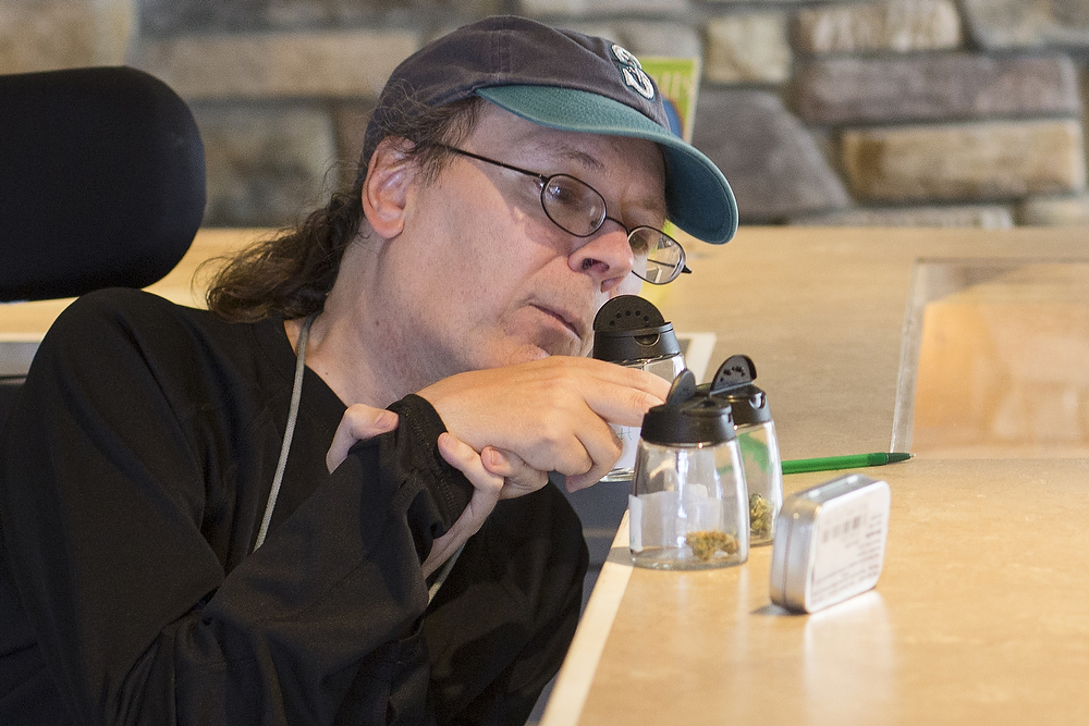 Bellingham resident Patrick Lenihan, 50, samples different strains 2020 Solutions on 2018 Iron St. on Thursday, July 10, 2014, in Bellingham. Lenihan said he waned wanted to be a part of this historic occasion. He hadn't purchased marijuana in more than 30 years, but decided to try some with an elder relative, he said.