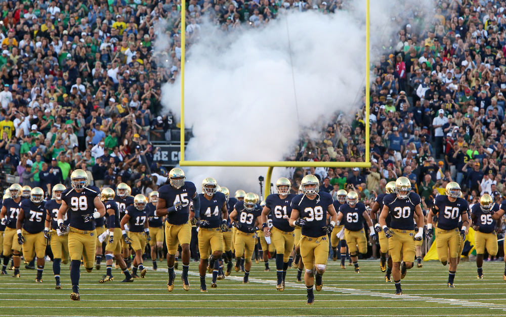 Notre Dame takes the field just before facing off against Michigan for their final game, Saturday, Sept. 6, 2014.The Fighting Irish won 31-0.