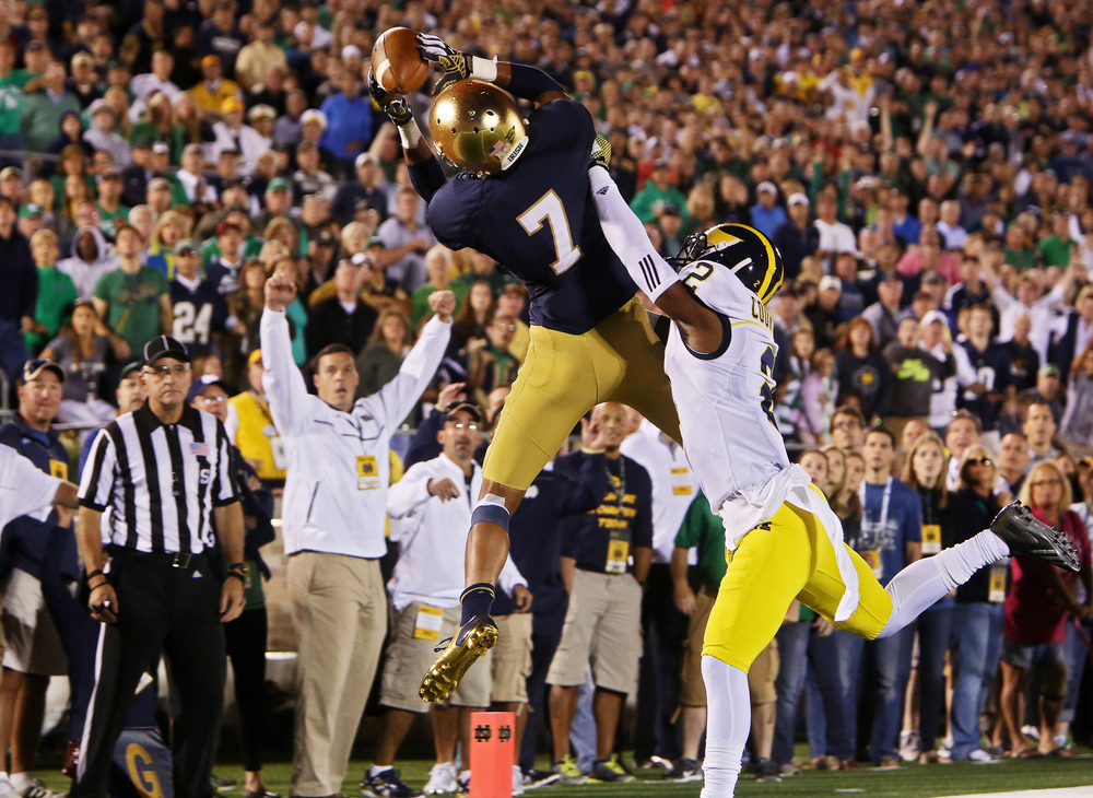 Notre Dame's William Fuller (7) catches a touchdown pass over Michigan's Blake Countess (2) at the end of the second quarter on Saturday, Sept. 6, 2014, at Notre Dame Stadium. The Fighting Irish won 31-0.