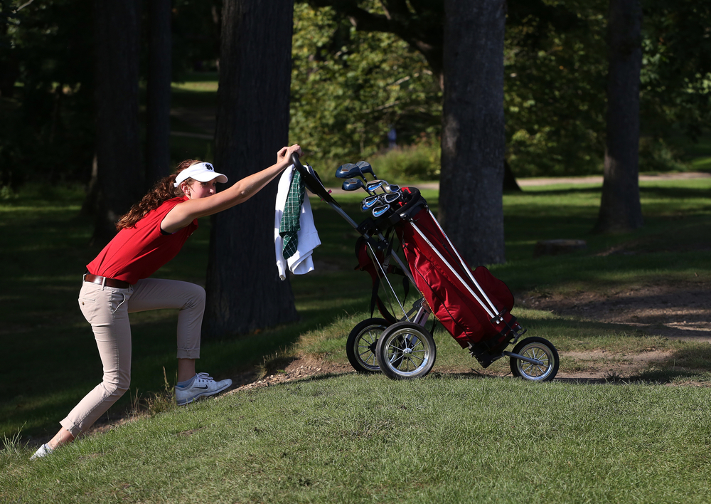 Memorial senior Chloe Klein struggles to climb a small hill on the fourth hole during a game against Central during senior day on Wednesday, Sept. 17, 2014, at Christiana Creek Country Club in Elkhart. Central beat Memorial 206-237.