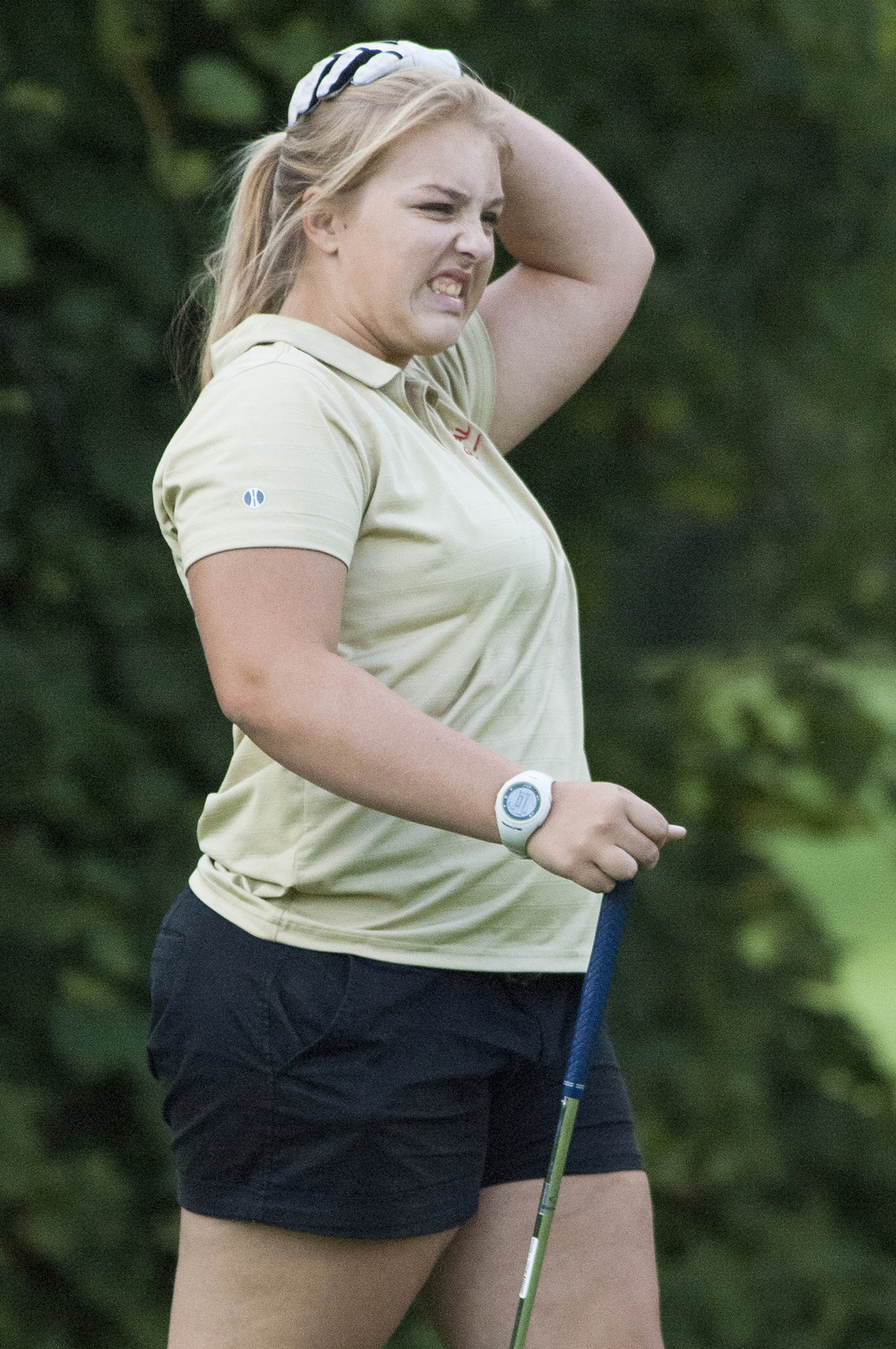 Memorial senior Jamie Brodnick reacts to a missed put on the fourth hole during a game against Central on senior day, Wednesday, Sept. 17, 2014, at Christiana Creek Country Club in Elkhart. Central beat Memorial 206-237.