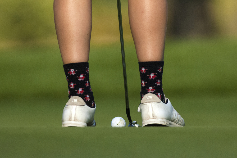 Central senior Aubrey Castleman sports santa socks during a warm September day, as Central hosts Memorial's girls golf team on senior day, Wednesday, Sept. 17, 2014, at Christiana Creek Country Club in Elkhart. Central beat Memorial 206-237.