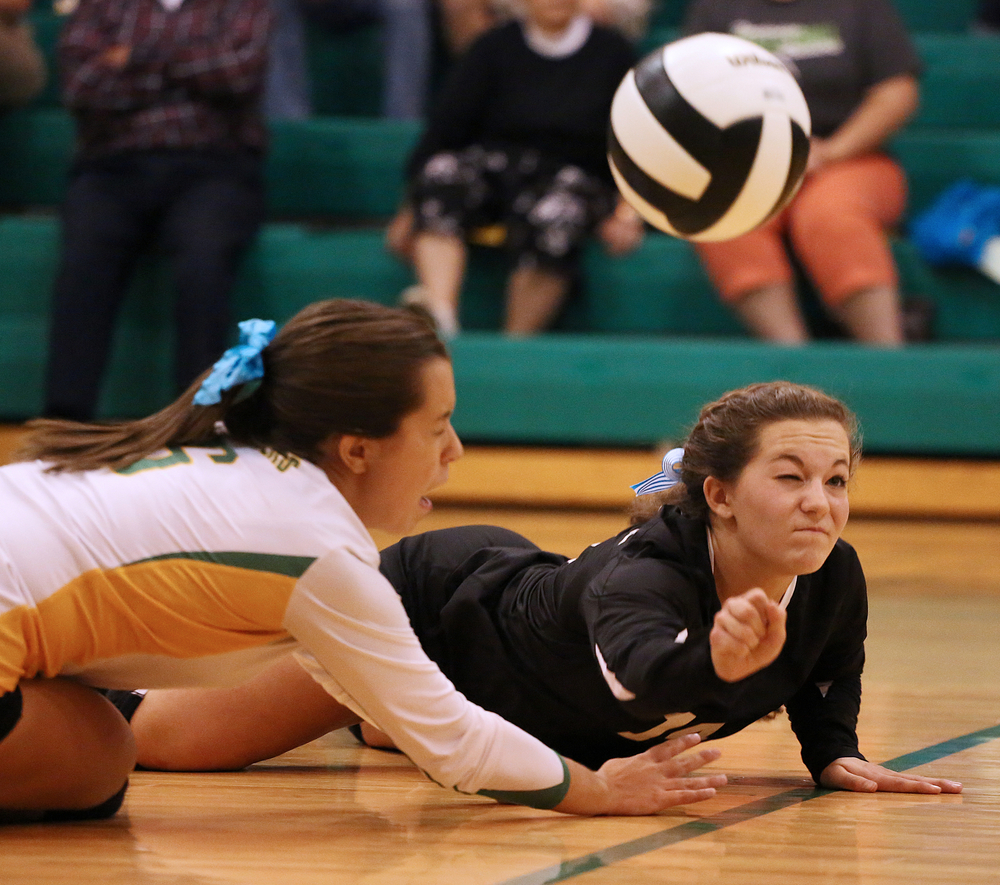 Northridge junior Kaitlyn Kennedy (14), right, and senior Carlee Christner (6) dive for a dig but could not get it to a teammate on Thursday, Sept. 25, 2014, at Northridge in Middlebury. NorthWood beat Northridge 3-1.