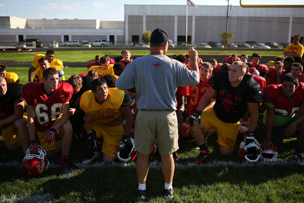 Memorial senior Dustin Ellsworth (68), left, listens to head coach Bill Roggeman speech about getting excited for a game the next day, on Thursday, Sept. 18, 2014, at Memorial.