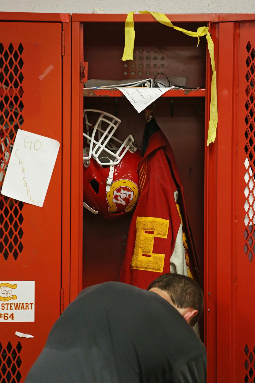 Memorial senior Dustin Ellsworth's helmet and letter jacket is seen hanging in his locker on Thursday, Sept. 18, 2014, in the Memorial locker room.