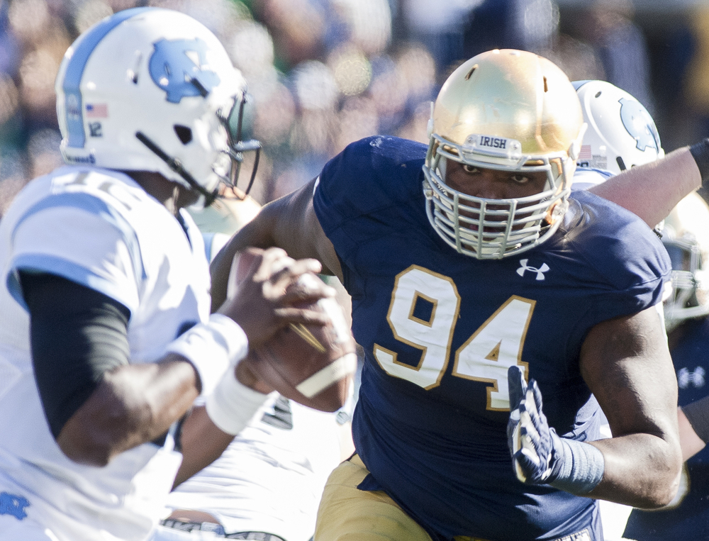 Notre Dame's Jarron Jones (94) keeps his eyes locked on North Carolina's quarterback Marquise Williams in the first quarter on Saturday, Oct. 11, 2014, at Notre Dame Stadium in South Bend. The Fighting Irish beat the Tar Heels 50-43.