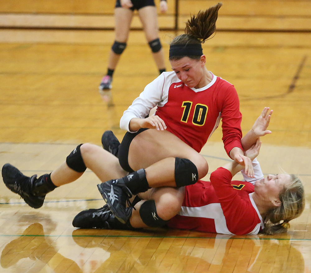 Memorial's Jill Brown (10) collides with Tailor Schultheis (7) after both going for the ball in the 4A volleyball sectional final against Concord on Saturday, Oct. 25, 2014, at Concord in Dunlap. The Crimson Chargers beat the Minutemen 25-18, 25-17, 26-24.