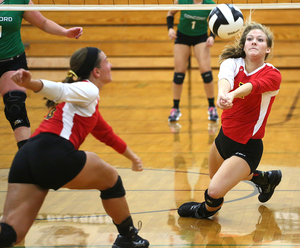 Memorial's Tailor Schultheis (7), right, makes a falling bump as Jill Brown (10) comes to support in the 4A volleyball sectional final against Concord on Saturday, Oct. 25, 2014, at Concord in Dunlap. The Crimson Chargers beat the Minutemen 25-18, 25-17, 26-24.