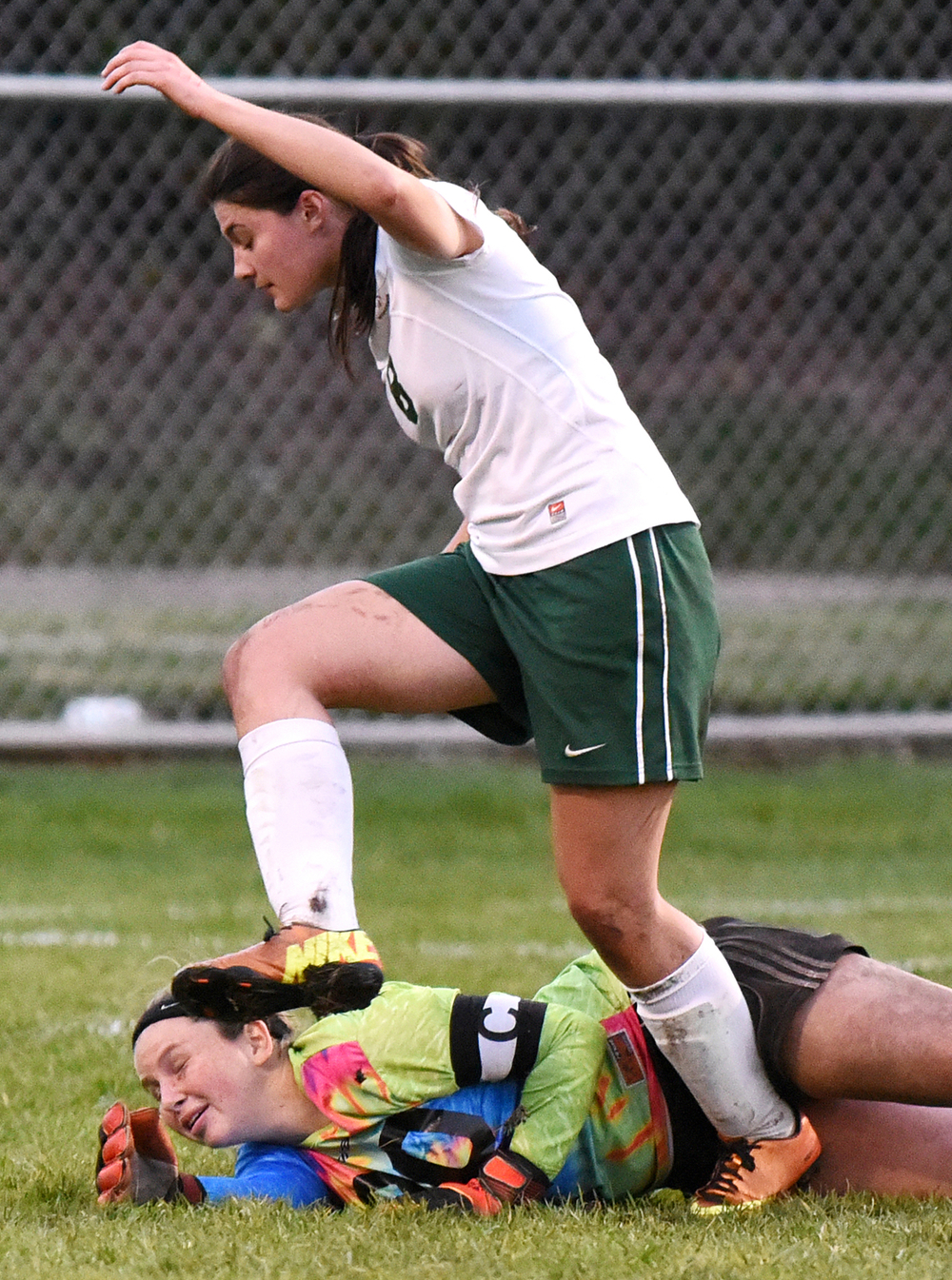 Concord senior Cheyenne Szobodi (8) tries to avoid stepping on her own goalkeeper and captain Kiley Harmon (00) during a sectional game on Tuesday, Oct. 7, 2014, at Central in Elkhart. Concord beat Northridge 4-1.