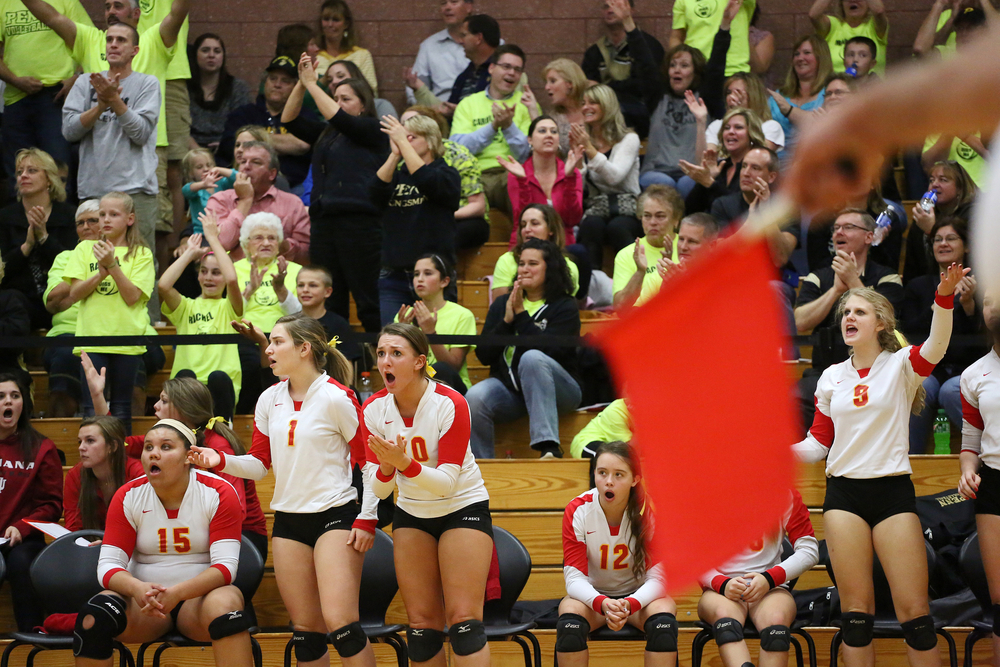 Memorial's bench reacts to a call going against them, as Penn fans, behind, them cheer on the Kingsmen in the 4A volleyball regional championship on Tuesday, Oct. 28, 2014, at Memorial in Elkhart. The Crimson Chargers beat the Kingsmen 25-11, 25-11, 30-32, 25-13.